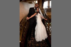bride and groom, full-length portrait on stairwell