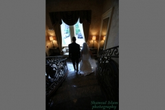bride and groom walking downstairs