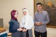 Safaa (center) and young woman and man to her left and right, all Syrian refugees recently settled in Florida