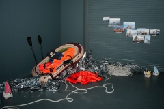 Falk Lehmann (AKUT) installation with refugee raft and lifejackets, part of the Awareness & Prevention Through Art (aptART) exhibition at the Gary Nader Art Centre, Miami
