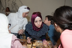 Syrian woman at Safaa's Kitchen catering table