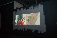 "video installation by Falk Lehmann (AKUT) at the Awareness & Prevention Through Art (aptART)'s ""Refuge in Paint exhibit"" at the Gary Nader Art Centre"