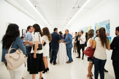 """guests at the Awareness & Prevention Through Art (aptART)'s """"Refuge in Paint exhibit"""" at the Gary Nader Art Centre"""